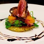 Blushing duck breast on maple roasted butternut squash & thyme potato rosti w/ black pepper dres