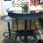 High top bar table made from iron wheels with tractor seat bar stools, orders taken