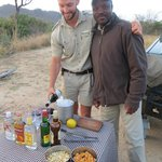 "Our ranger and tracker treated us to a ""sundowner"" in the wild."