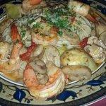 Shrimp and artichokes on pasta.