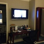 Wall with TV, desk and full length mirror/ironing board cabinet