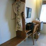 desk, tv, refrigerator, tea coffee station, hanging station