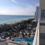 View of gorgeous hotel pool, beach from balcony