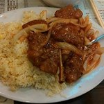Pork Chop with fried rice and onions