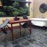 Table and bath on balcony