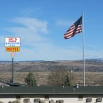 Sign and US Flag as seen from Shell Truck Stop