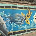Murals on the walls of US den