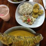 Broiled fish, rice, salad, plantains