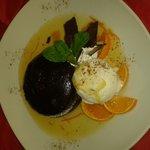 warm chocolate fondant grand marnier sauce, ginger & marmalade ice cream