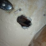 08/13 - Hole under sink can clearly see into adjoining room. Rooms right above office.