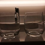 Glass on the right is clearly rinsed wiped and returned the glass on the left was brought up whe
