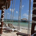 View from beach cabana with swings.