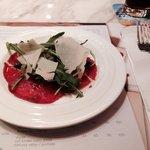 Beef caparccio with rocket leaves
