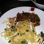 Shredded lamb with bean sauce served with  noodles on my plate