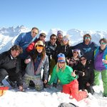 group photo over looking the swiss alps