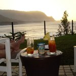 Mai tai and macadamia nut sunset over Hanalei Bay