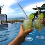 lounging in the pool, drinking caipirinhas in the water