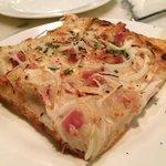 Pizza al Taglio: pancetta, Parmesan cheese, Vidalia onions & mozzarella.