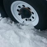 """Tires in ice at least 4-6 """" deep the middle of March. They will never get out."""