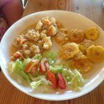 Lobster, salad, and tostones.