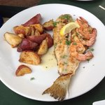Grilled redfish and shrimp with new potatoes.