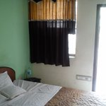 My room with balcony and a nice painting on the wall