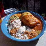 Chicken chimichonga with refried beans, rice and sauces