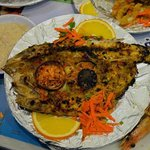 Golden Groupers fish (Wa'ar - وقار) cooked in oven, they call this way of cooking Sangari
