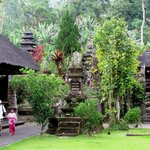 A father and child leaving through the entrance courtyard of Pura Luhur Batukaru
