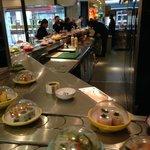 Yo Sushi in Selfridges, food running in a belt