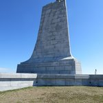 photo of the monument on top of a hill you can walk up