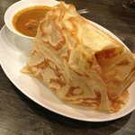 Roti Canai served with a bowl of Curry