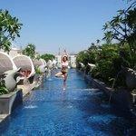 Enjoying yoga at the swimming pool
