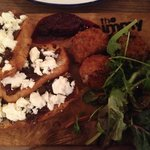 feta cheese with caramelised red onion on toast on the left, beef n stilton croquettes on the ri