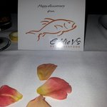 Happy anniversary card with rose petals on the table. A lovely touch from a lovely restaurant th