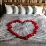Rose petals on the bed for a romantic evening!