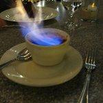 Flaming Creme Brulee dessert.