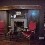 Comfortable chairs near fireplace