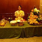 Thai lady making greeting garlands at entrance level (the hotel reception is on a higher floor).