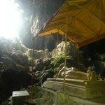 Buddha statue inside cave
