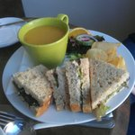 Lovely lentil soup with sandwich.