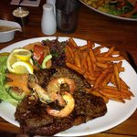 My t-bone with sweet potato fries and I asked for some prawns they were great
