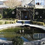 This the fishpond with an ancient garden feature in the background!
