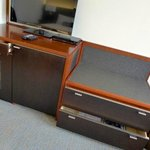 Luggage table and cupboard with fridge