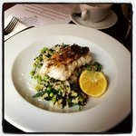 Hake on a bed of pea and broccoli risotto