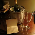 Complimentary champagne with handwritten note from staff