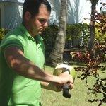 Gardener Cutting me a coconut