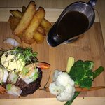 Main - 8 hour slow cooked rib fillet, roasted garlic butter prawns & bugmeat, hand cut chips, st