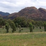 Belougery Split Rock dwarfs the camping areas
