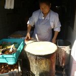 Street vendor preparing jianbing (Chinese crepes)